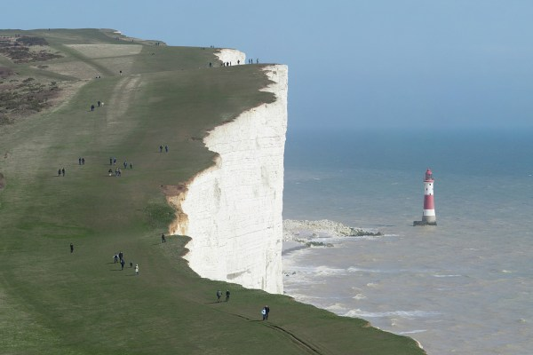 """The cliffs of Beachy Head and the Lighthouse below, as viewed along the South Downs Way in East Sussex, England."" by Diliff, Papa Lima Whiskey"
