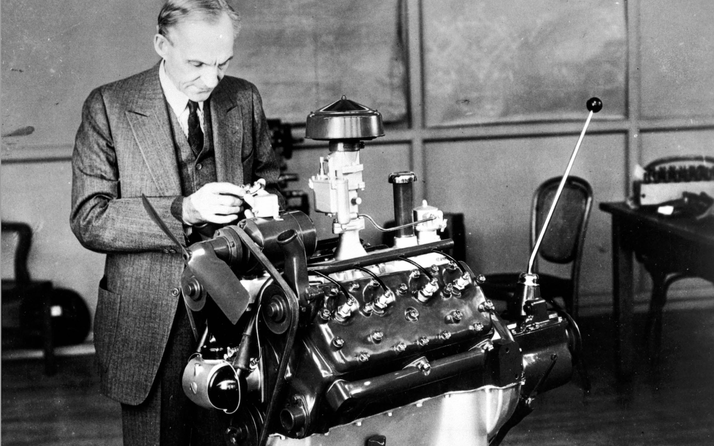 small resolution of henry ford looking at an engine