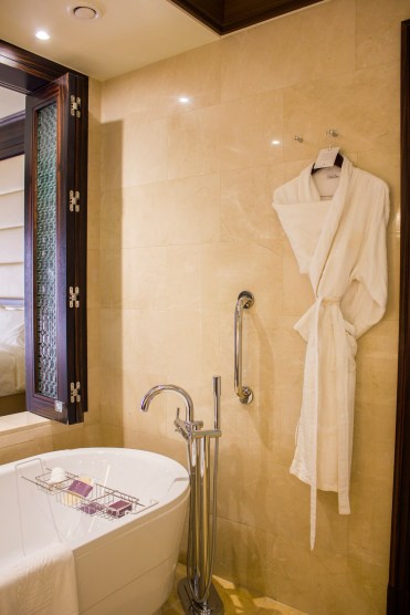 Bathtub & robe at The Ritz-Carlton Abu Dhabi