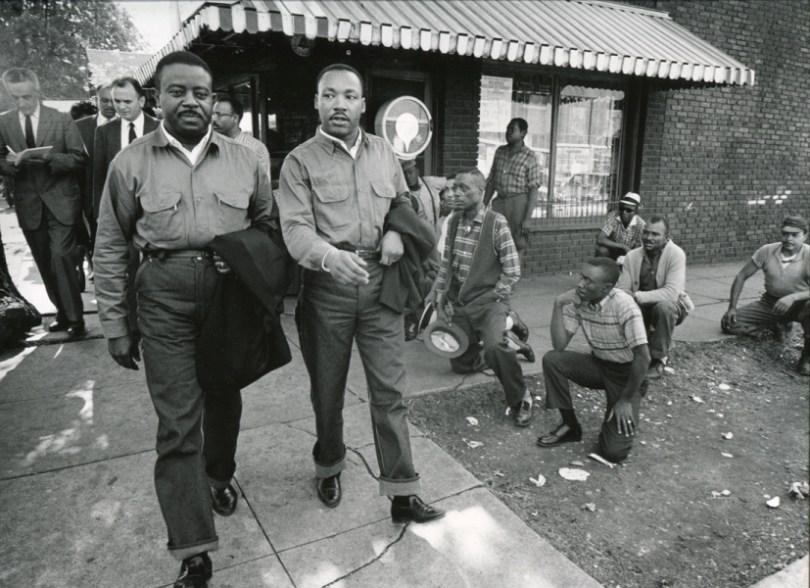 Martin Luther King Jr. and Ralph Abernathy walk toward their arrest in Birmingham, Alabama, April 16, 1963.