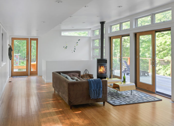 living room designs with wood stove decorating ideas green couch modern warmth fine homebuilding article image