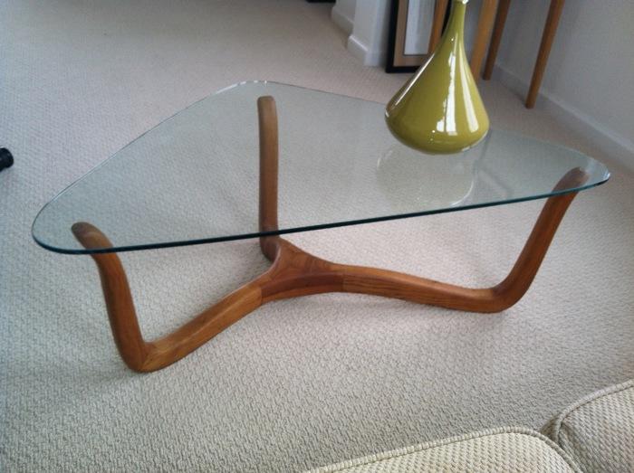 glass topped three legged coffee table