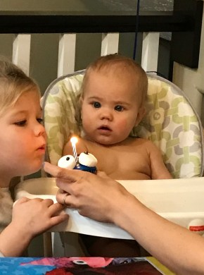Sister Raegan helping to blow out the candle
