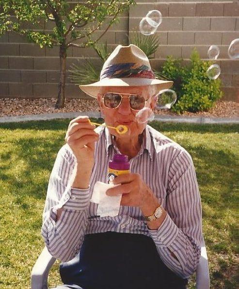 Grandpa Wells blowing bubbles