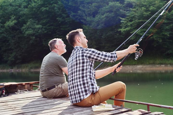 Son and father catching of fish