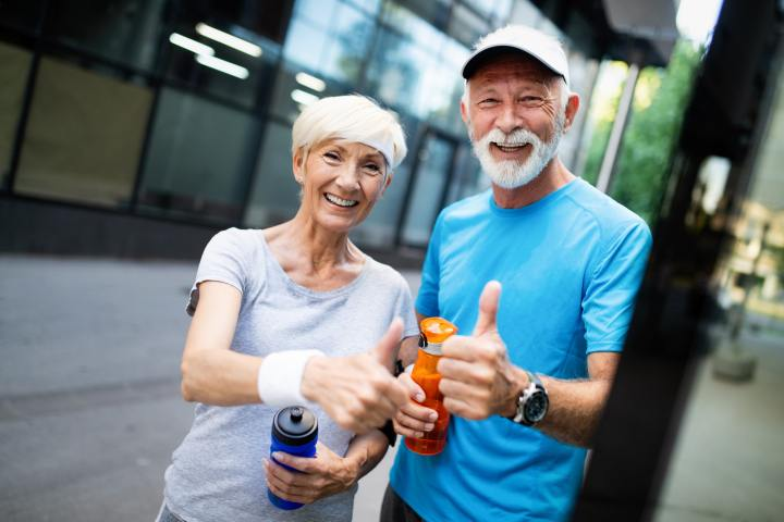 Running mature couple congratulate and happy to finish their morning workout
