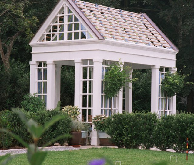 A Gorgeous Square Gazebo With Lattice Between The Pillars The Roof Resembles That Of A