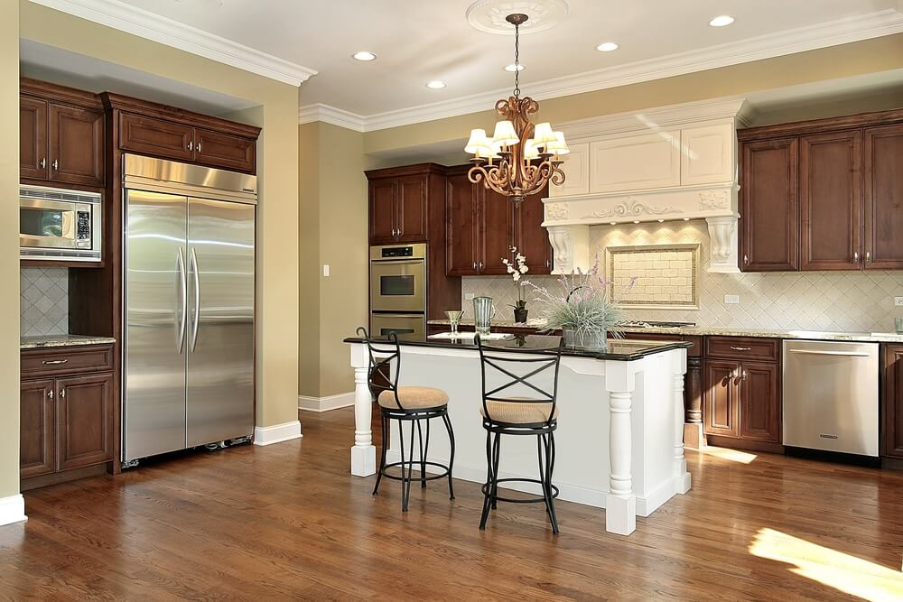different color kitchen cabinets wine themed rugs 43 kitchens with extensive dark wood throughout brightly lit is highlighted by a white island black countertop seated between