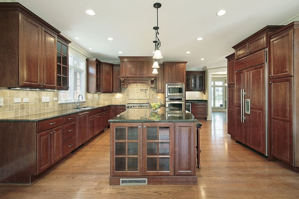 most popular kitchen cabinets cabinet lighting ideas 43 kitchens with extensive dark wood throughout light hardwood flooring and wooden cabinetry compliment each other in this featuring tile