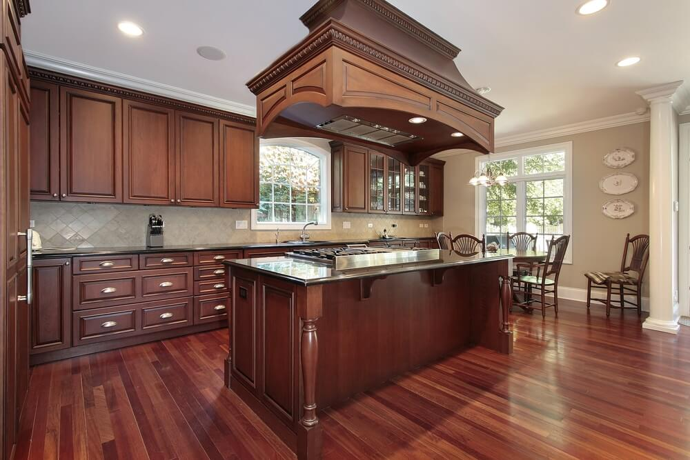 living room ideas with cherry wood floors decorating for rooms accent wall 43 kitchens extensive dark throughout rich abounds in this kitchen featuring a massive island built range