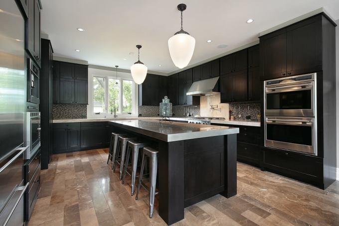 Contemporary Craftsman Style Kitchen With Black Wood Cabinets On A Light Floor The Is Offset Stainless Steel Throughout