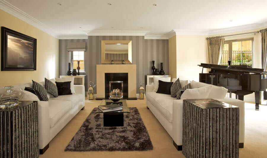 elegant living room design warm bright colours for 36 rooms that are richly furnished decorated minimalist black white and beige theme unifies this featuring lengthy