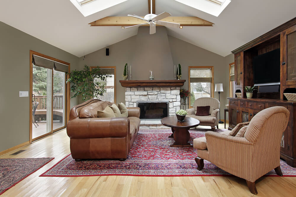 bright colored living room rugs colours with grey sofa 54 rooms soaring 2-story & cathedral ceilings