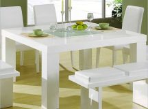 Our second square table design features a glossy white surface and ultra-minimalist design, perfect for brightening any space.