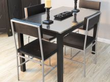 Metal tabletops bring a modern, hard edged touch to any dining room. The material is stain resistant, hardy, and cool to the touch, and fits well with industrial or contemporary styled spaces.