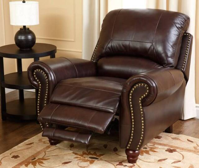 This Luxurious Leather Recliner Features Nail Head Trim Thick Cushioning On The Seat And Back