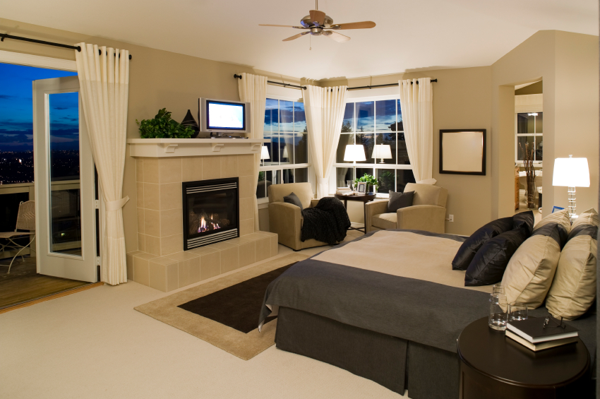 Upscale master bedroom with fireplace