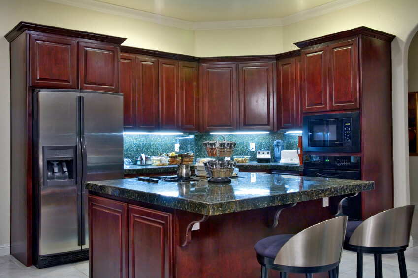 small island for kitchen sink protectors 20 clever ideas your photos a eat in with rich cherry wood cabinets and stainless steel appliances