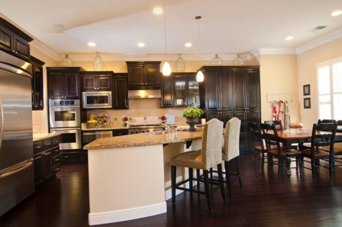 This Fantastic Kitchen Has A Sleek Dark Wooden Floor The Cabinets In E Correspond