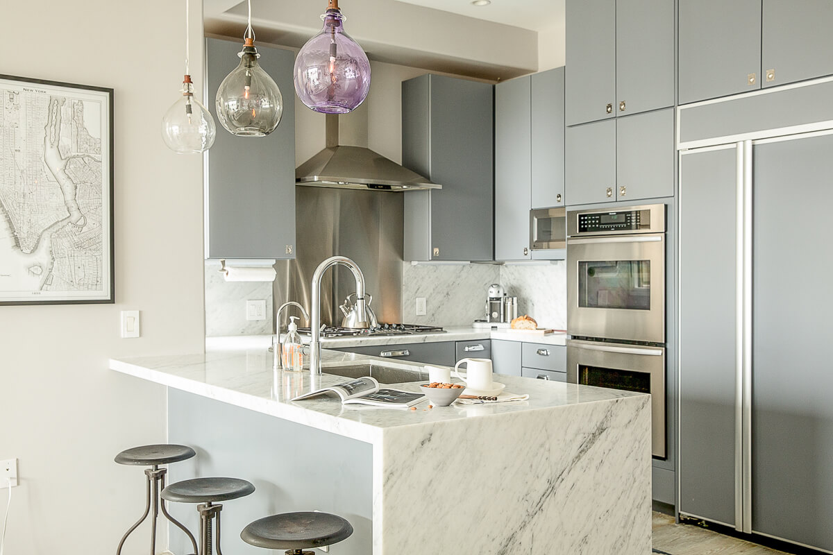 flat front kitchen cabinets rustic faucets yet minimalist airy home full of worldly treasures