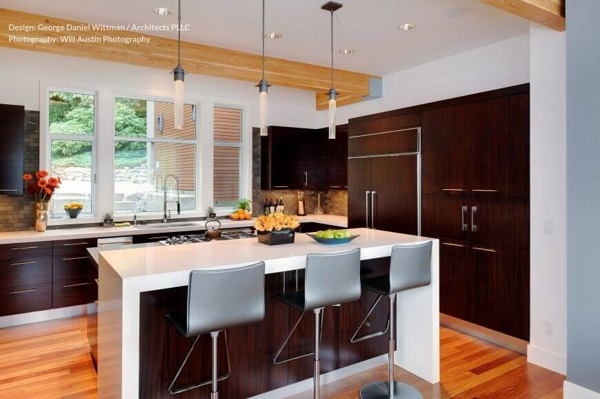 kitchen island with stove apple rugs 25 spectacular islands a pictures another high contrast this example features dark natural wood cabinetry contrasting white countertops
