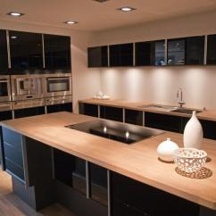 Kitchen Island With Stove Organizing 25 Spectacular Islands A Pictures This Sleek High Contrast Modern Features Glossy Black Cabinetry Juxtaposed Against Light Natural Wood