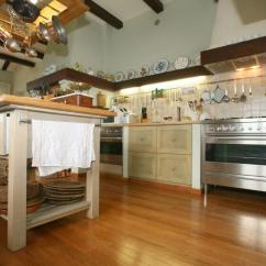 Pot Racks For Kitchen Island Countertop 35 Kitchens With Hanging Pictures This Rack Doubles As A Light Fixture Over The In Quaint Cottage
