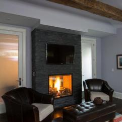 Small Living Room Tv Fireplace Modern Design For Apartments 49 Exuberant Pictures Of S Mounted Above Gorgeous Fireplaces This Dark Stone Mantle Contains A Roaring Fire Peaceful Reading Area Television