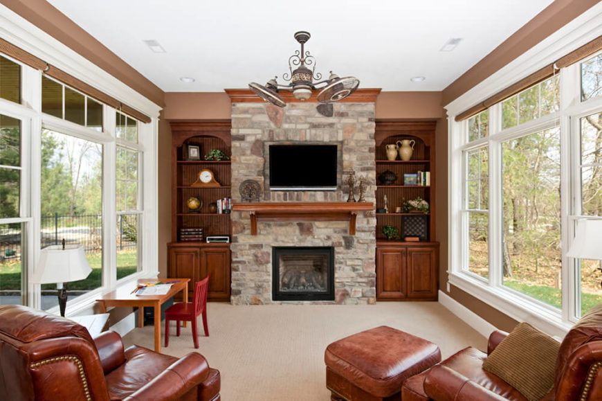 pictures of living rooms with fireplaces and tv large room mirror 49 exuberant s mounted above gorgeous this marvelous stone fireplace has a wooden mantle just under the television for extra storage space