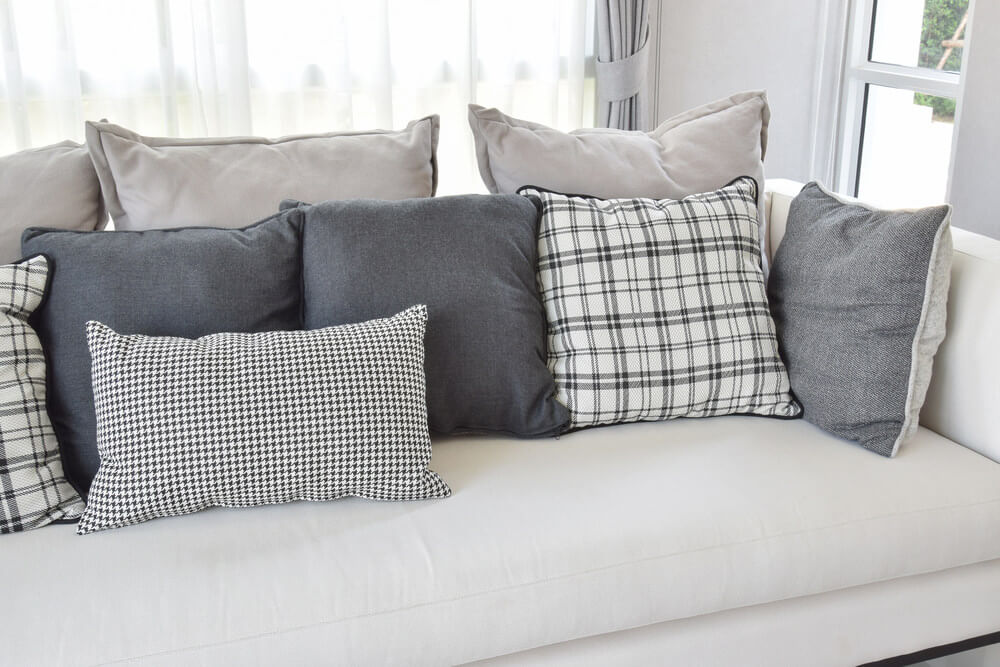 throw pillows for living room couch hollywood regency decorating ideas 35 sofa pillow examples decor guide home stratosphere white with charcoal grey and in a variety of patterns including geometric