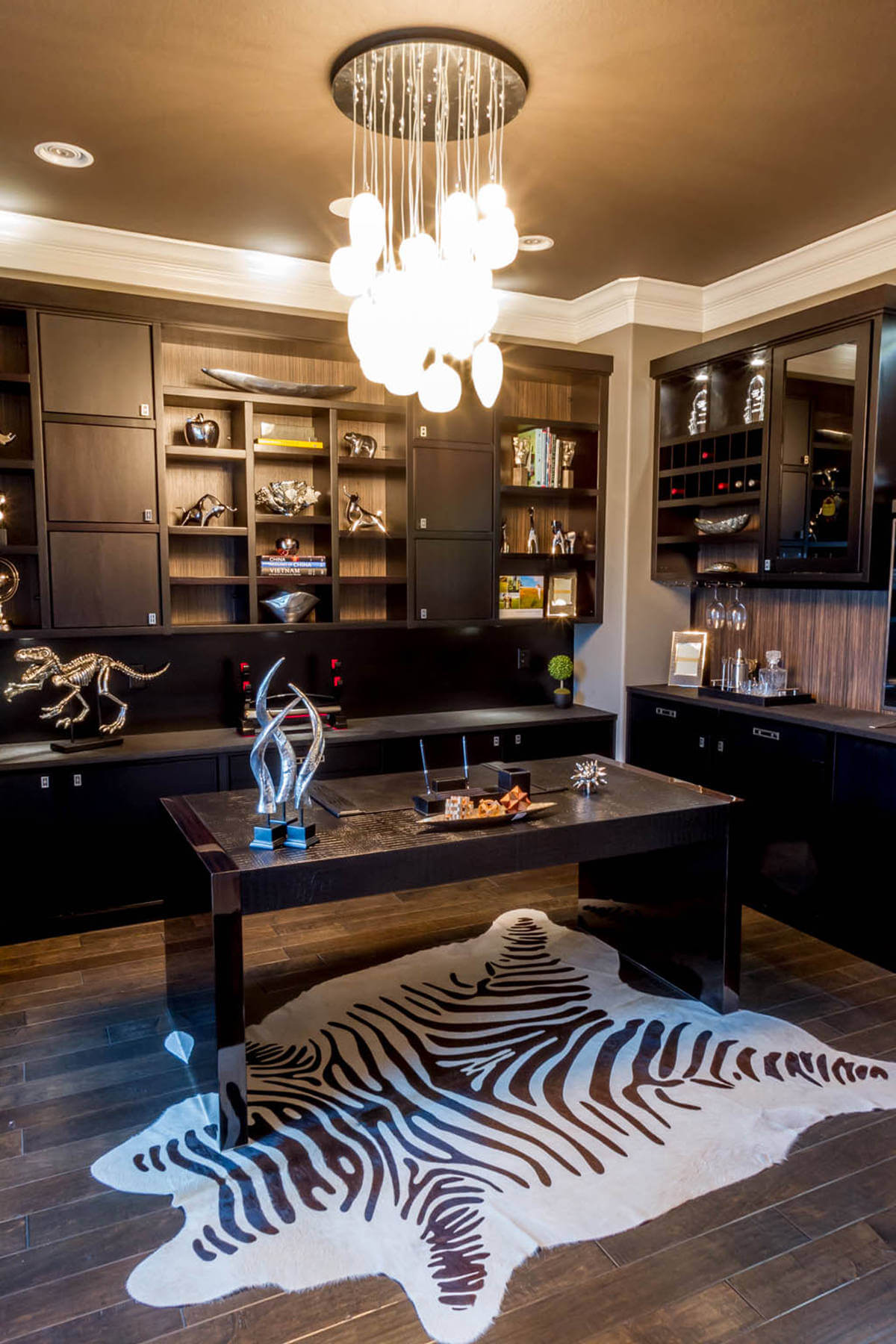 Masculine Home Office with Dark Contemporary Custom Furniture and Zebra Print Rug