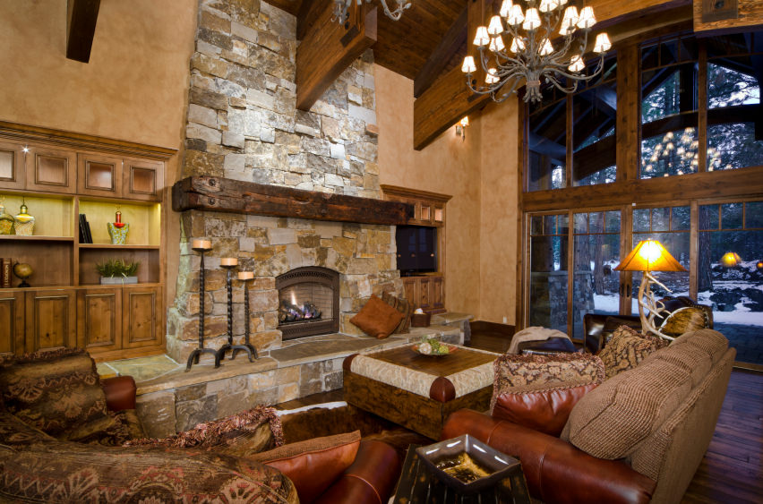 traditional style living room neutral decor 18 types of styles pictures examples for 2019 brick stone fire place provides warmth in this mixed and modern inspired chalet it