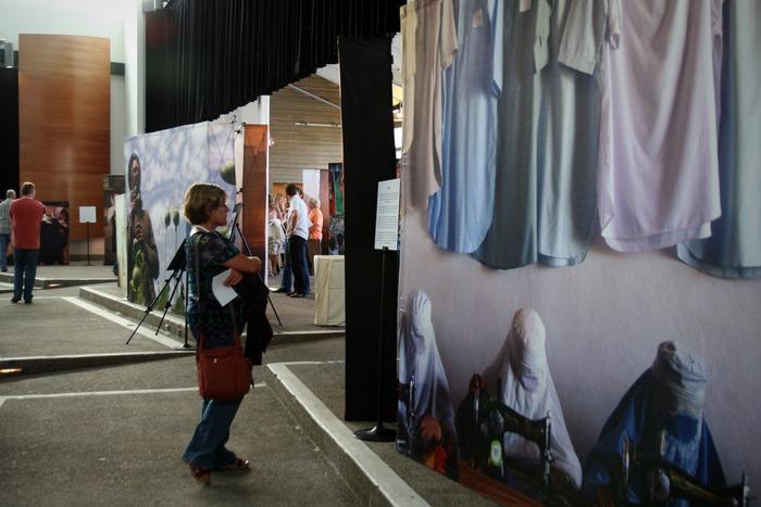 Viewers wander through the life-size photographs - Krystal Garvin