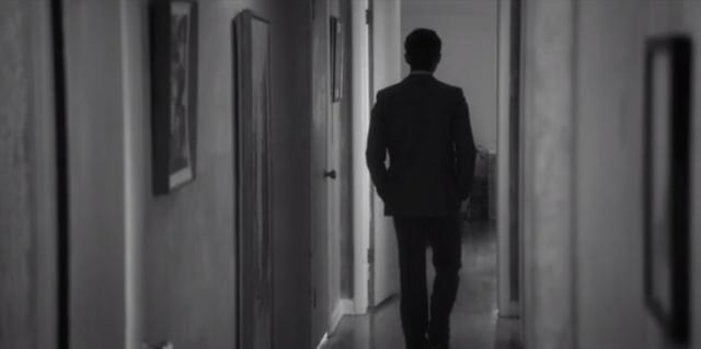 Actor Gopal Divan walks down a lonesome hallway.