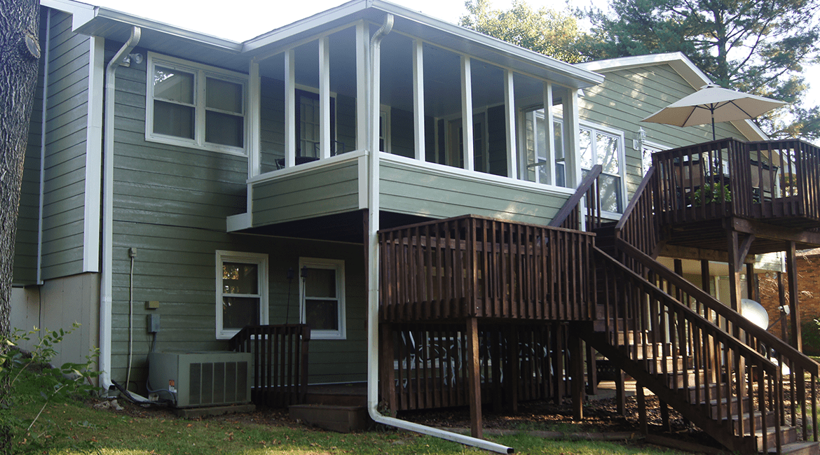 Screened in porch with attatched two-story deck