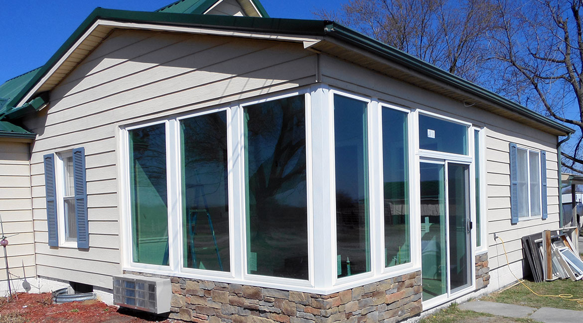 TrueSon Exteriors' progress as they install windows for a home.
