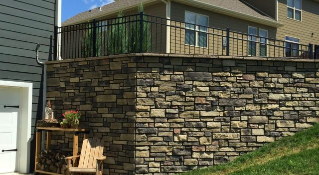 Cultured stone retaining wall by TrueSon Exteriors