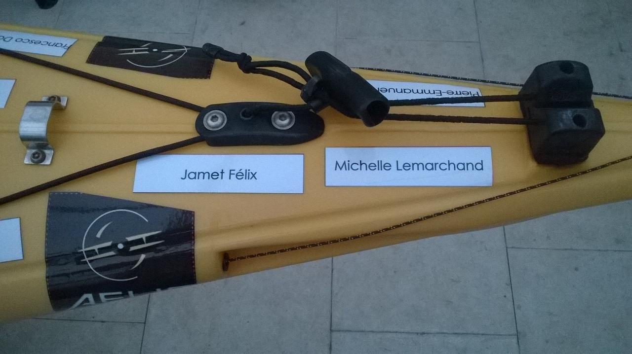 The names of people who have donated to Alexandre's cause adorn his kayak. (Photo by Tony Garner)