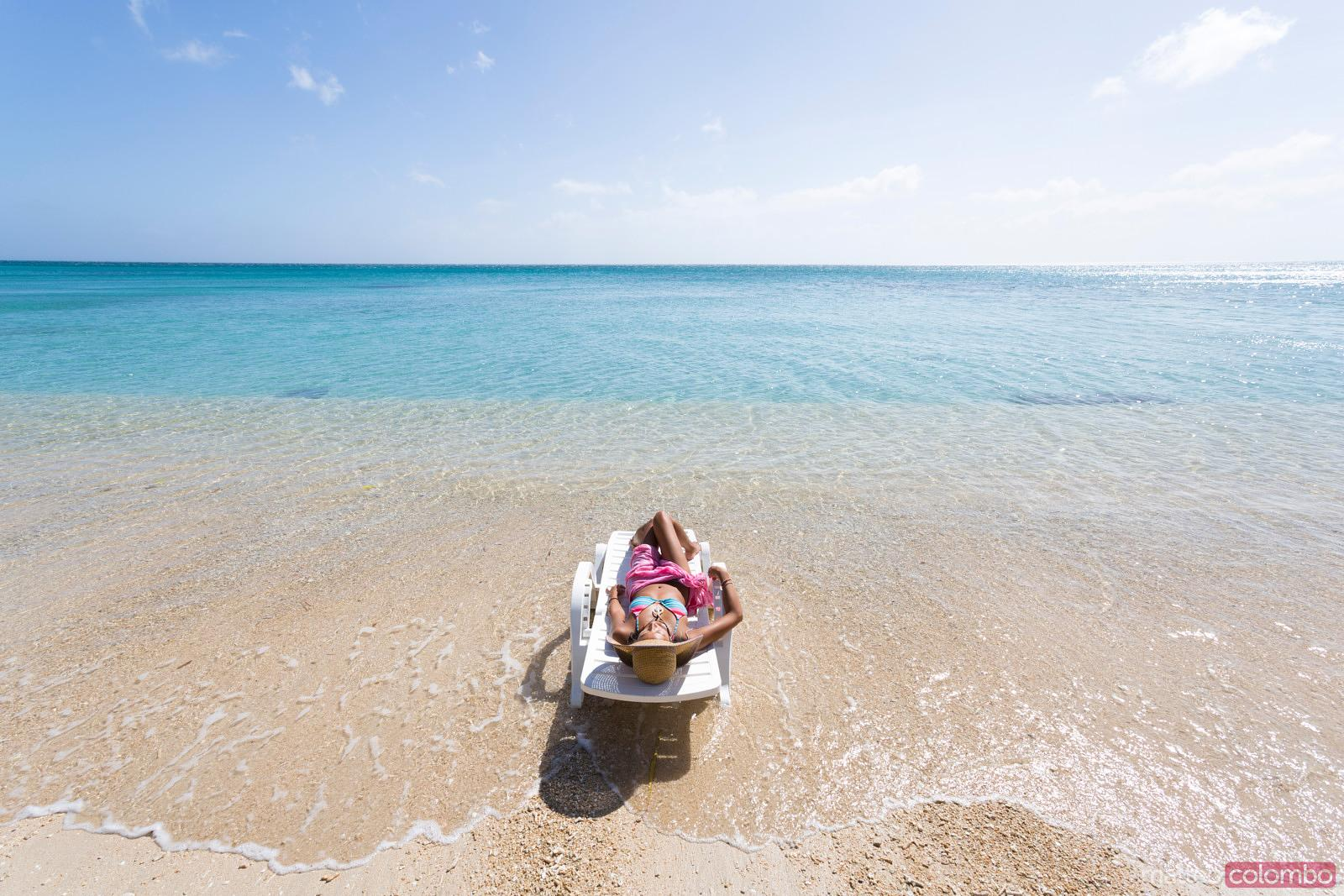 lay down beach chairs high top outdoor table and matteo colombo travel photography woman laying on