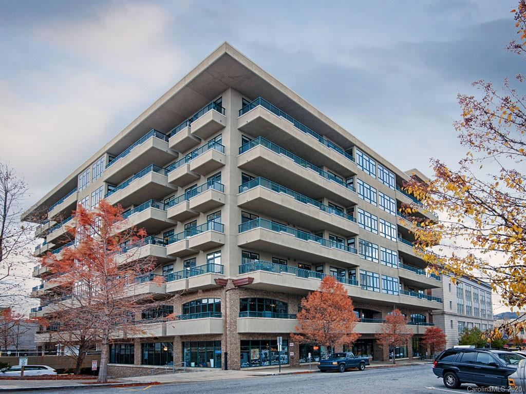 """Rare opportunity to own the """"penthouse"""" at downtown Asheville's most distinguished address!  Located on the top floor with panoramic eastern exposures of the downtown Asheville skyline surrounded by beaucatcher and town mountains, this massive residence offers attention to detail and luxurious appointments fitting one of the cities finest addresses.  Inside you'll find floor-to-ceiling windows that perfectly accentuate the surrounding views, ample natural light, a gourmet kitchen, a wet bar flanked by a massive distressed brick wall, two master suites, two fireplaces, a cozy media room with built in shelving that can easily be converted to a 3rd bedroom for guests,two separate balconies, and plenty of storage.  This unit comes with two dedicated parking spaces and a guest parking space that's available on a """"first come first served basis"""". All this in a building that's located steps from the shopping, dining, live music,craft beer, & art galleries that downtown Asheville is known for."""
