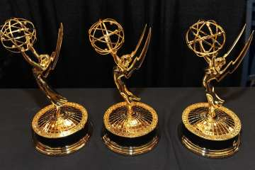 three emmy statues