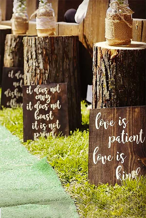 Bible verse for the wedding aisle or decor. Corinthians 13 (The Love is Patient, Love is Kind scripture) is written in rustic wedding style on eight signs. You could also use them to hang or on easels. Kendra stains them dark walnut with white writing. Look for these as the second or third buy product listing on the page. #RusticWedding #WeddingSigns #MyOnlineWeddingHelp #WeddingDecoration #ReligiousWedding