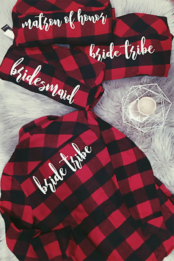 """Personalized long-sleeve wedding shirts are a great idea for bridesmaids and the bride. These plaid flannel bridesmaids shirts are also an awesome gifts idea for the maids in a Fall or Winter wedding. (Especially one with a rustic theme!) Get them like in the pic, with """"maid of honor"""" or """"bridesmaid,"""" OR have Katelin also add monograms on the front pockets. #BridesmaidsIdea #BrideIdea #MyOnlineWeddingHelp #BridesmaidsShirts #WeddingShirts #FallWeddingIdea #WinterWeddingIdea #BridesmaisGiftIdea"""