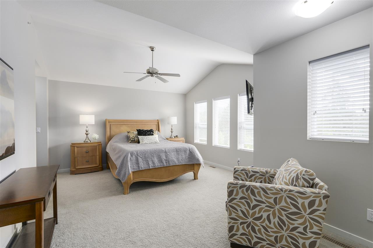 Vaulted master retreat bedroom including large walk-in closet