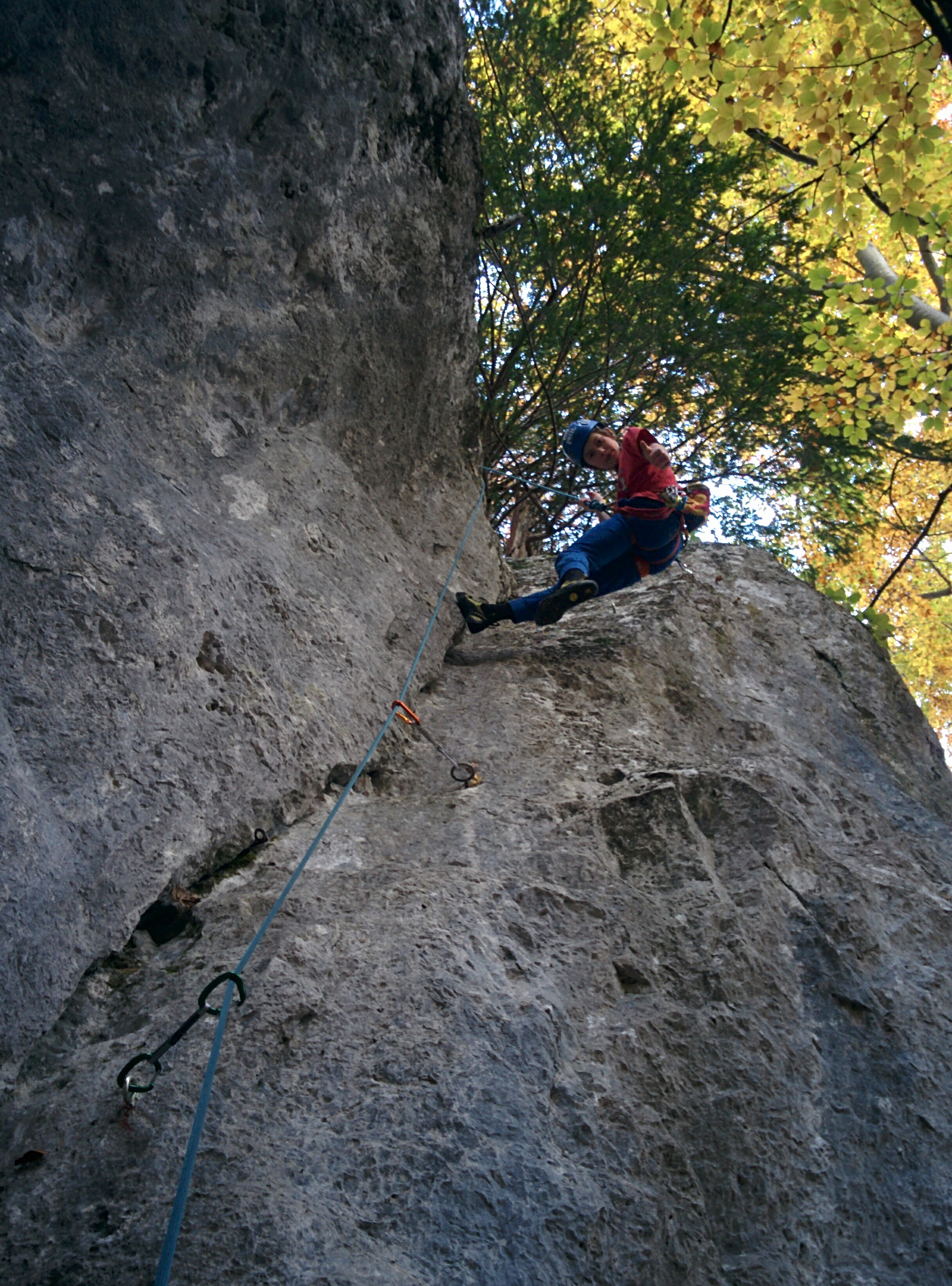 Max climbing Bear Cliffs near our property.