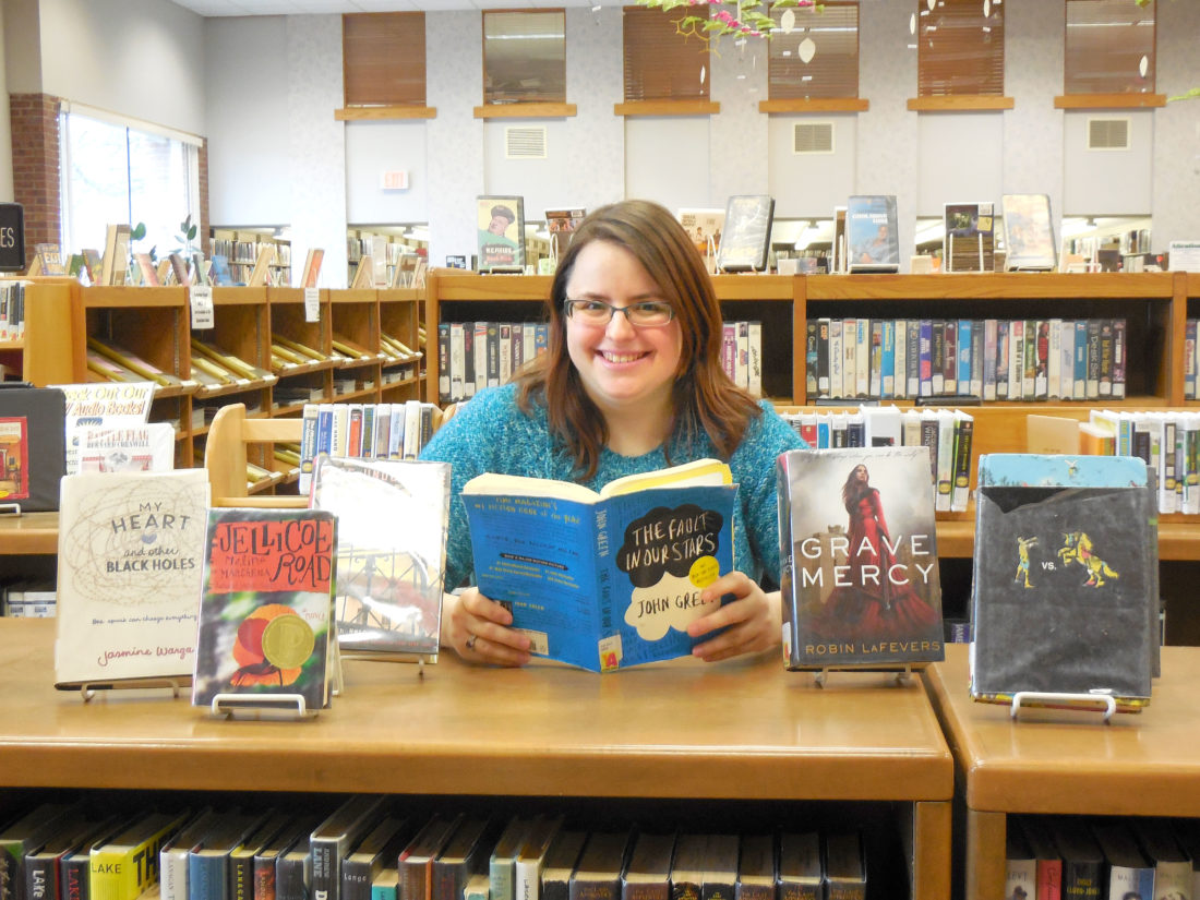 Celebrate Teen Literature Day on Thursday at the Dickinson County Library. Anyone who checks out a Young Adult book during Celebrate Teen Literature Day will earn a treat. Also, from 4 to 5 p.m. at all branches, tweens and teens are invited to a Silent Reading Party. Young adults in grades six to 12 who read quietly during the Silent Reading Party will earn a tasty treat. For more information, go to the library's website, www.dcl-lib.org, call us at 906-774-1218, or email dickinsoncountylibrary.ya@gmail.com. Amanda Griggs displays some great teen reads at the library.