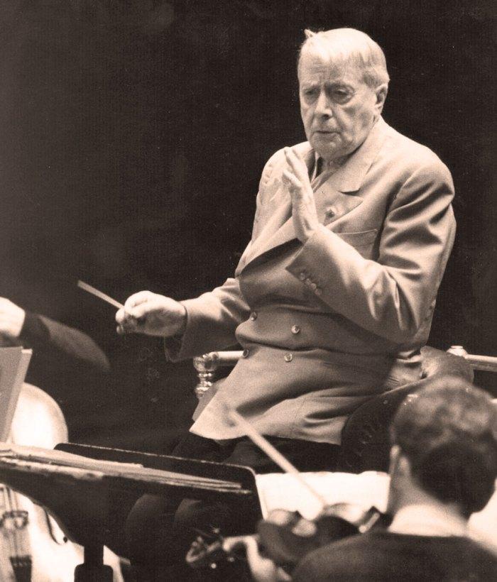 Charles Munch rehearsing Tcherepnin, Ravel and D'Indy this week.