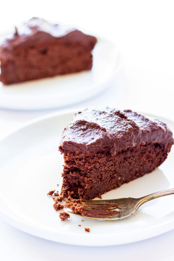 This healthy and decadent double chocolate chia cake is made of 100% real food ingredients. It is extra moist, rich and bursting with flavor. Easy to make, this delicious and versatile dessert is perfect for the novice baker. It is also paleo, gluten-free, eggless and flourless making, it the perfect guilt-free dessert or snack. With added protein, this recipe is also perfect as a post-workout treat. | onecleverchef.com
