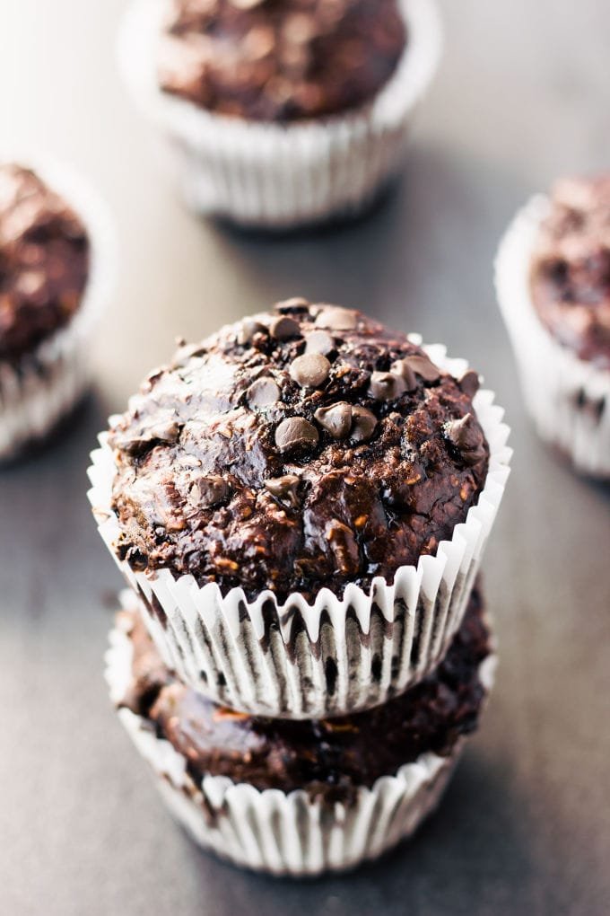 These delicious chocolate protein muffins are the perfect way to reward yourself after a hard workout. Super moist and cakey, these healthy chocolate protein snacks are naturally sweetened with banana and maple syrup. Gluten-free, vegan, dairy-free, egg-free, flourless, kid-friendly and refined sugar-free. | www.onecleverchef.com