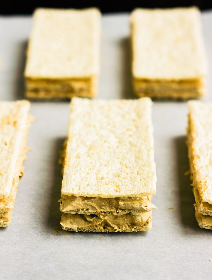 These healthy & homemade kit kat protein bars are easy to make and require only 4 simple ingredients. These extra crunchy, no-bake protein treats are the perfect post-workout snack. They are entirely gluten-free, paleo, vegan, dairy-free, egg-free, flourless and nut-free. | onecleverchef.com